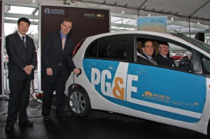 Applied Materials' Chief Technology Officer Mark Pinto (right) and Han Wenke, Director General of the Energy Research Institute of the National Development and Reform Commission (left) demonstrate an electric vehicle powered by solar energy. Passengers include Saul Zambrano, Director, Clean Air Transportation, Pacific Gas and Electric Company (left) and Hal LaFlash, Director, Emerging Clean Technology Policy, Pacific Gas and Electric Company