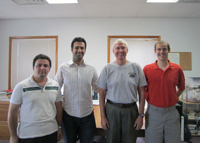 Virginia Tech's Reza Arghandeh, an electrical and computer engineering Ph.D. candidate, second from left, works with his adviser Robert Broadwater, professor of electrical and computer engineering, third from left