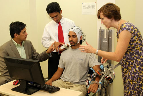 From left, Gerard Francisco, Jos� Luis Contreras-Vidal and Marcia O'Malley work with a University of Houston (UH) graduate student testing MAHI-EXO II, a robotic rehabilitation device