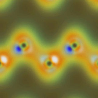 Simulated valence-charge density from x-ray and optical wave mixing shows the nuclei of carbon atoms as dark spots