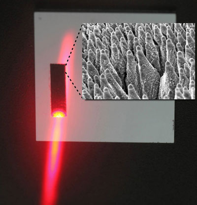 Black silicon is irradiated with a laser. Small image: Black silicon, magnified