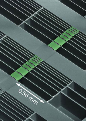 array of optomechanical accelerometer devices formed in the surface of a silicon microchip