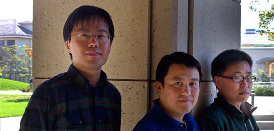 Professor Shanhui Fan (center), post-doctoral scholar Zongfu Yu (right), both of the Stanford School of Engineering, and doctoral candidate Kejie Fang (left)
