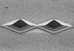 Laterally coupled nanopyramids
