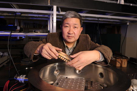 Xinwei Wang shows the instruments they used to study the thermal conductivity of spider silk