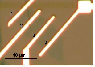 Optical microscopy image of graphene layer with multiple contacts for measuring graphene's electrical resistance