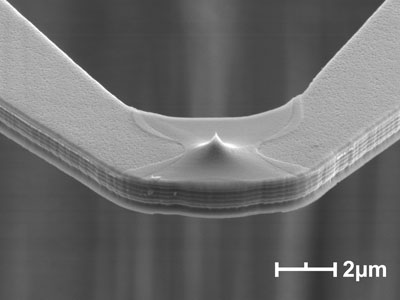 Scanning electron microscope images of a nanoheater cantilever with a sharp tip